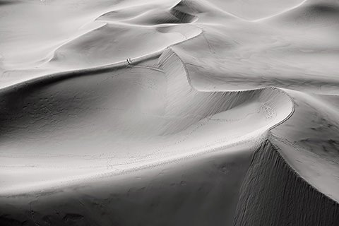 Walking on mountains of sand